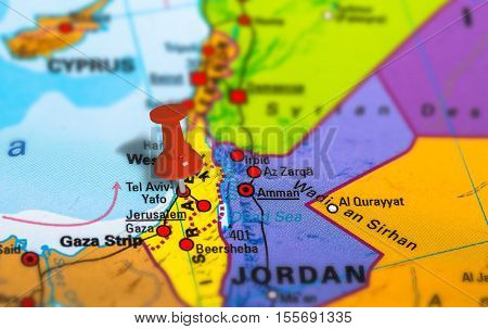 Tel Aviv in Israel pinned on colorful political map of Middle East. Geopolitical school atlas. Tilt shift effect.