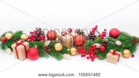 Christmas or New Year background: fur-tree, branches, colored glass balls and toys, decoration on a white background
