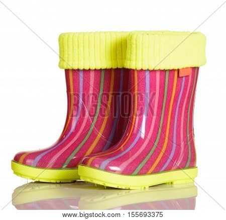 Children rubber boots with fabric inset for walking in the rain and after isolated on a white background.