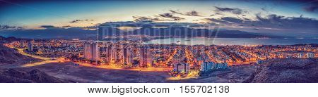 Panoramic aerial view on the Eilat (Israel) and Aqaba (Jordan) cities and northern shore of the Aqaba gulf, Red Sea. Toned image for retro style