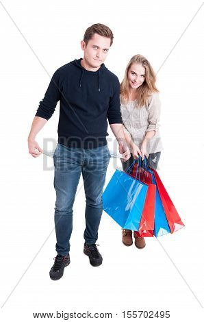 Couple Holding Shopping Bags Showing Empty Pockets