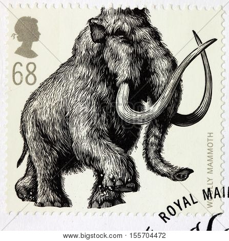 LUGA RUSSIA - NOVEMBER 6 2016: A stamp printed by GREAT BRITAIN shows Woolly Mammoth - Ice Age Animal circa 2006
