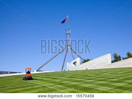 Mowing the lawn over Parliament House in Canberra