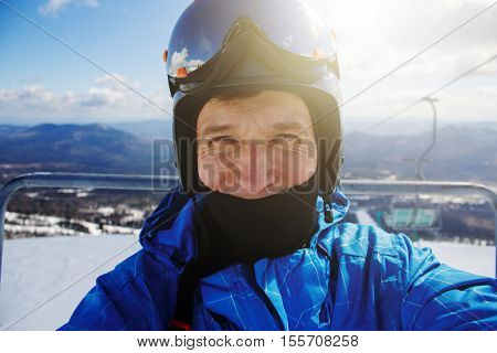 Portrait of the skier / snowboarder with the setting sun in the background