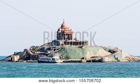 Vavathurai Kanyakumari India - January 20 2012: Swami Vivekananda Rock Memorial on the small island in Laccadive Sea - a famous tourist monument at a sunny day in Vavathurai Kanyakumari India