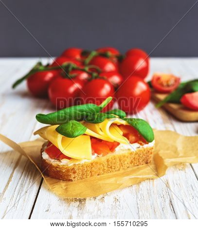 Bruschetta With Spinach And Cherry Tomatoes On Toasted Baguette