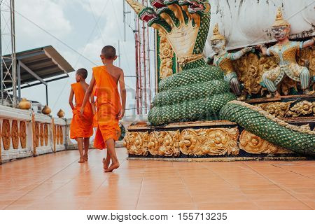 Monks At The Temple, Krabi, Thailand