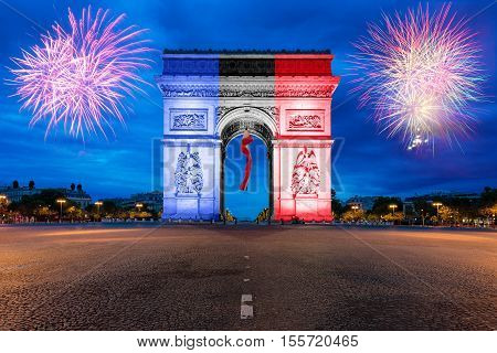 Arc de Triomphe Paris and Champs Elysees with New year firewoks at Paris France.