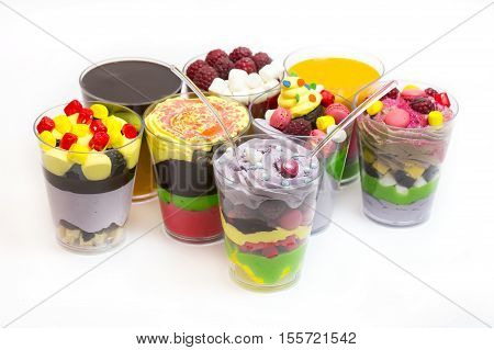 Dessert in plastic cups cream with fruit and pastries and mousse