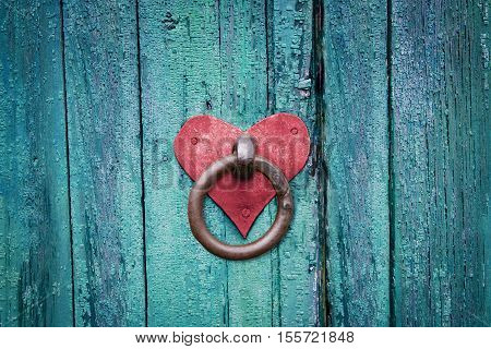Old rusty gate latch on wooden door