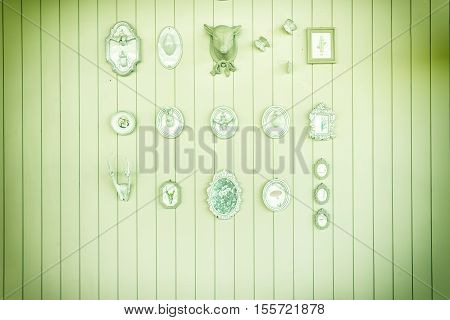 abstract decorations hanging on wall with vintage filter