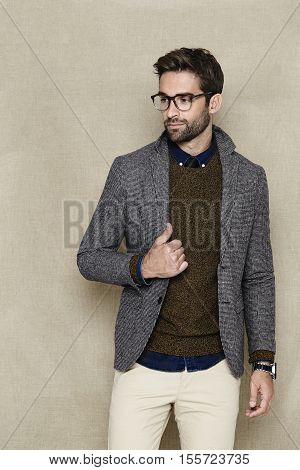 Dude in jacket and spectacles looking away