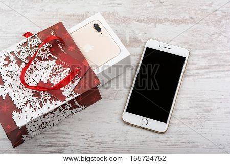 BURGAS, BULGARIA - OCTOBER 22, 2016: New Apple iPhone 7 Plus Gold on white background, Christmas gift, illustrative editorial.