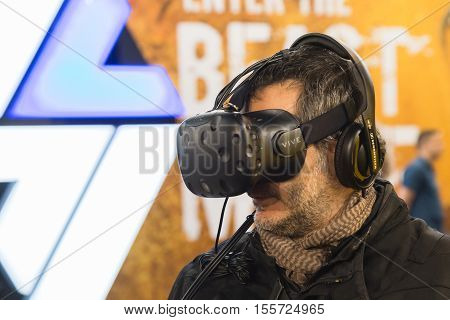 Man Trying Virtual Reality Headset At Eicma 2016