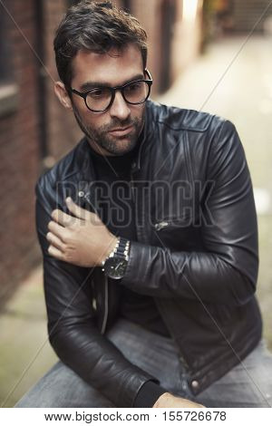 Cool dude in leather jacket and glasses