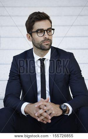handsome Businessman in blue suit looking away