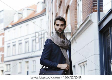 Smart model in scarf and blazer portrait