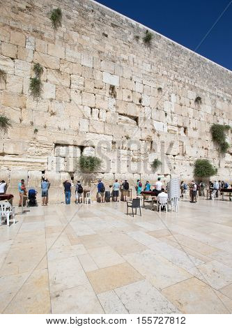 ERUSALEM, ISRAEL - June 24, 2015 : Jewish worshipers pray at Wailing Wall , Israel
