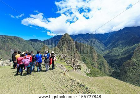 MACHU PICCHU NOVEMBER 11: Tourists walk in Machu Picchu site on November 11 2015 in Machu Picchu.