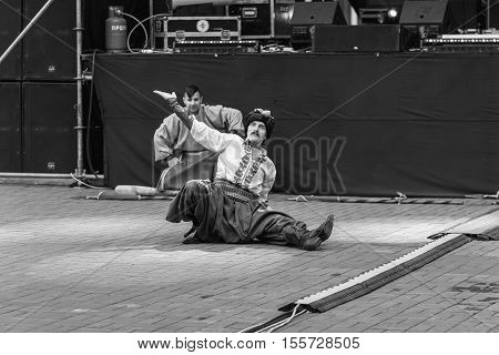 Dneprodzerzhinsk Ukraine - October 15 2016: theatrical performance of Ukrainian cossacks dances and elements of combat with sabers