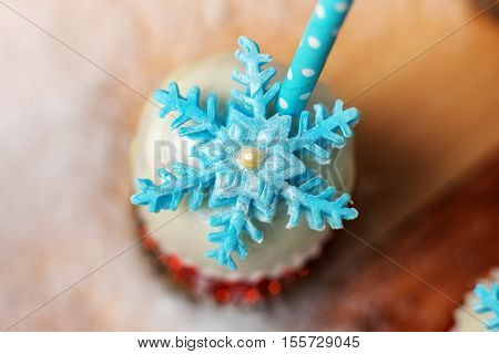 Lollypop closeup on the snow. Decorated with sugar snowflakes.