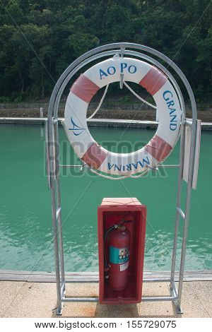 PHUKET THAILAND - JUNE 272016 : Life preserver and Fire extinguishers in harbor 272016 at Ao Po Paklok Phuket Thailand