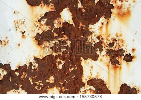 Corroded white metal background. Metal background with rusted spots.