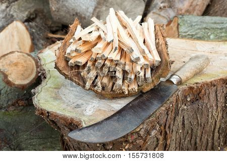 Pile Of Firewood Stick And A Machete
