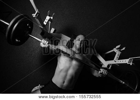 Brutal Athletic Man Pumping Up Muscles.