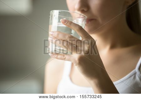 Female Drinking From A Glass Of Water