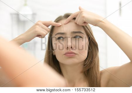 Young Woman Worried Checking Wrinkles On Her Forehead
