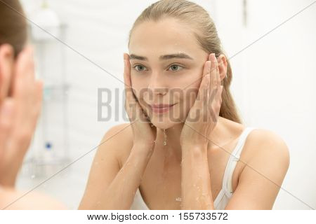 Young Girl After Washing Her Face Water Near The Sink