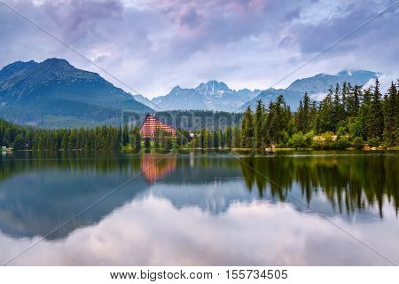 Breathtaking mountain views and a quiet lake chained the viewer's eye. wildlife inspires.in Strbske Pleso lake Slovakia Tatra mountains.