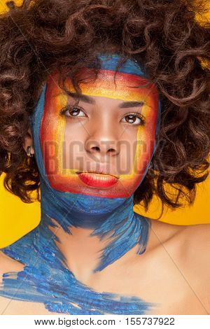 Afro American Girl On Yellow Background With Beauty Square Make Up