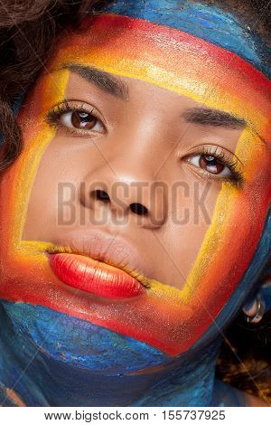 Afro American Girl In Beauty Image With A Square Creative Make Up