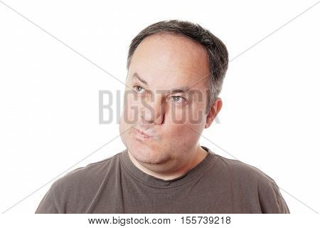 skeptical middle aged man making a face and twisting his mouth