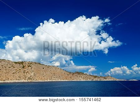 Blue sky and sea landscape with mountains white clouds
