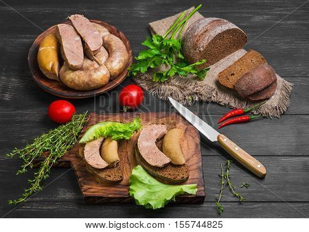 Sandwiches bread with homemade sausage. Loaf rye bread for sandwiches with homemade sausage. Assorted homemade sausage rings. Ingredients for sandwiches sausage thyme parsley peppers.