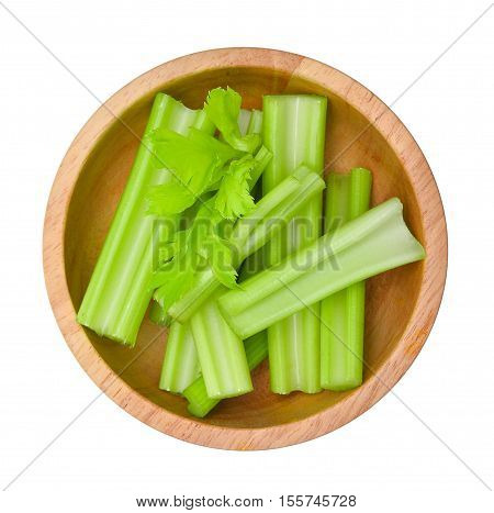 top view of fresh slice celery in wooden bowl isolated on white