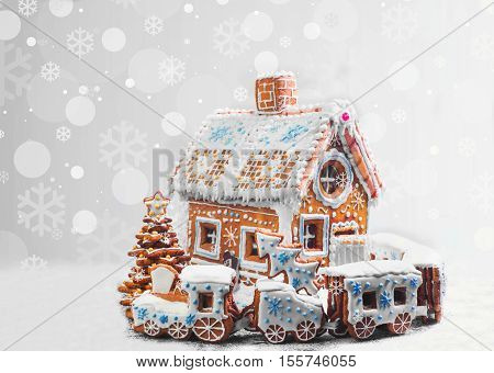 Assorted Christmas gingerbread cookies. Christmas gingerbread village house train tree. Christmas New Year's background with snowflakes. Christmas card with gingerbread village.