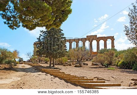 The ruins of the ancient Greek Temple of Juno Lacinia located in archaeological site famous as the Valley of the Temples Agrigento Sicily Italy.