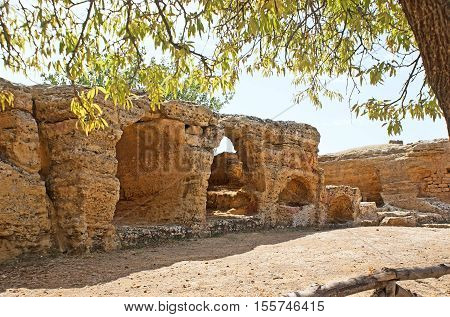 The Arcosolia - stone wall with the carved arches for the tombs in Agrigento archaeological site Sicily Italy.