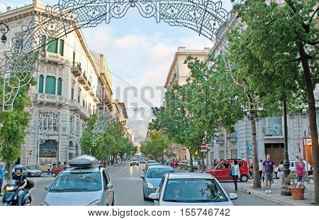 PALERMO ITALY - OCTOBER 2 2012: The traffic in street of Roma (Via Roma) one of the main shopping areas of the city on October 2 in Palermo.