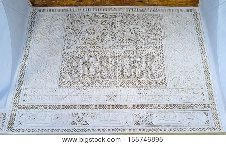 KAIROUAN TUNISIA - AUGUST 30 2015: The The fretwork on wall of Zaouia Sidi Sahab (Barber's Mosque) decorated with Islamic patterns with stellar and floral motives on August 30 in Kairouan.