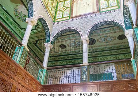 KAIROUAN TUNISIA - AUGUST 30 2015: The arched gallery in Mansion of Governor decorated with carved painted and fretwork details on August 30 in Kairouan.