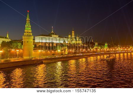 In the evening the Moscow Kremlin and Moskva River become golden due to the bright city illumination Russia.