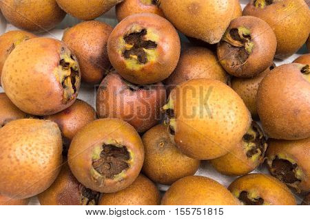 Bunch Of Raw Medlar Fruits Background