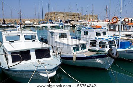 Crete, Greece - June 14, 2006: Fishermen boats in the Iraklio harbor