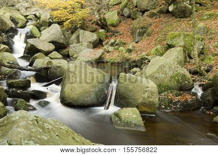 Burbage Brook flows down the rocky river valley of Padley Gorge on the Longshaw Estate Peak District Derbyshire UK