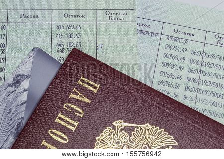 Passport, passbook opened pages and bank card